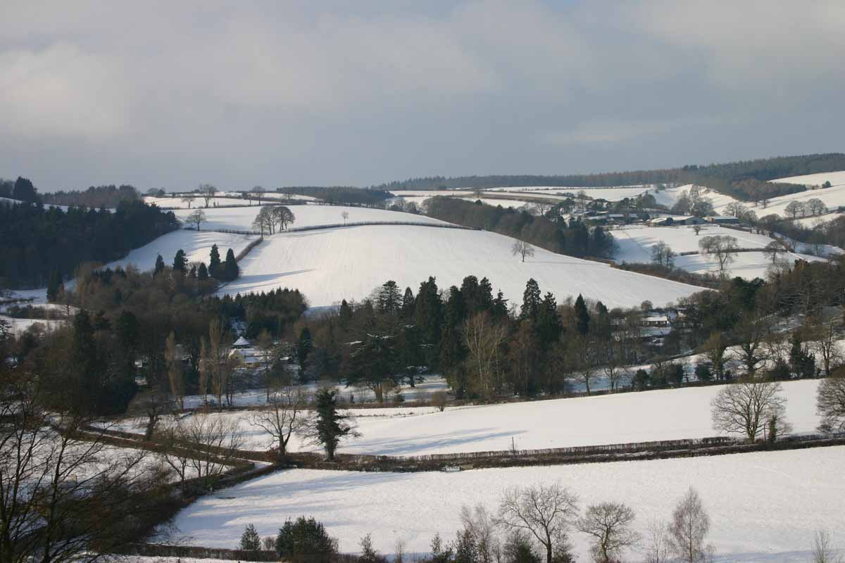 Looking down on Hopesay in the snow