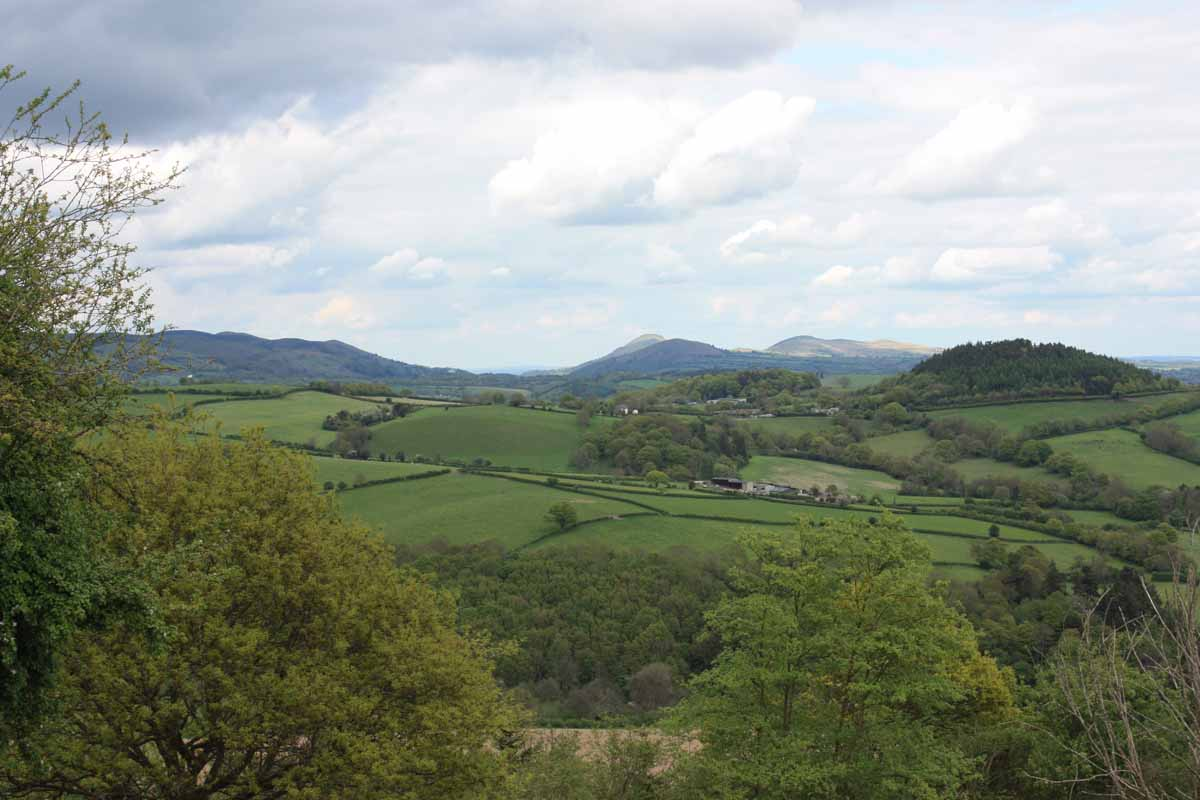 A distant view of Caradoc and the  Long Mynd from the Burrow